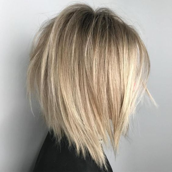 a V-cut and razored blonde bob with a darker root will make your look ultra-modern