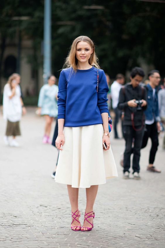 a blue sweatshirt, a creamy midi skirt, bright pink heels for a bright look