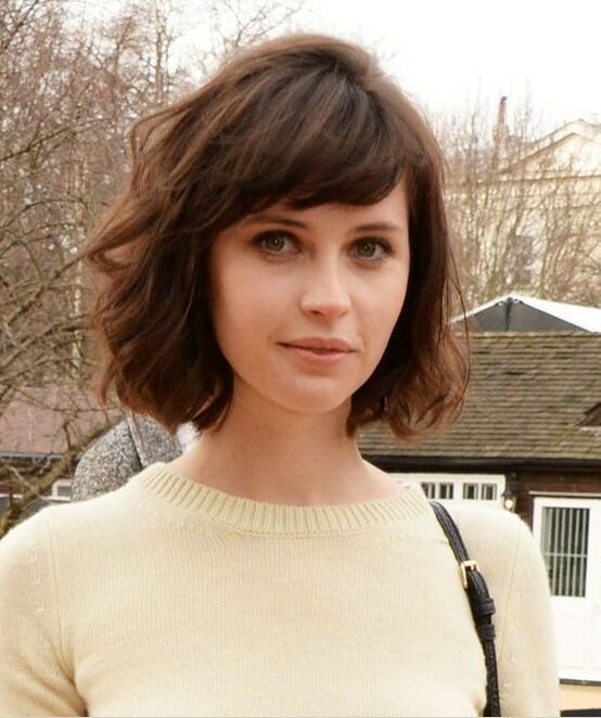 a formal bob haircut with side bangs looks rather romantic and cute