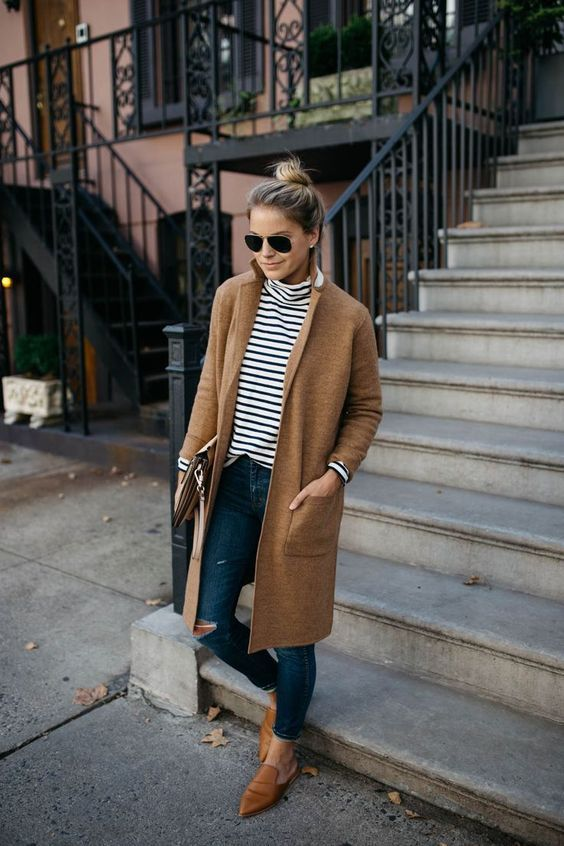 a striped top, ripped jeans, amber shoes and a camel coat for a relaxed weekened look