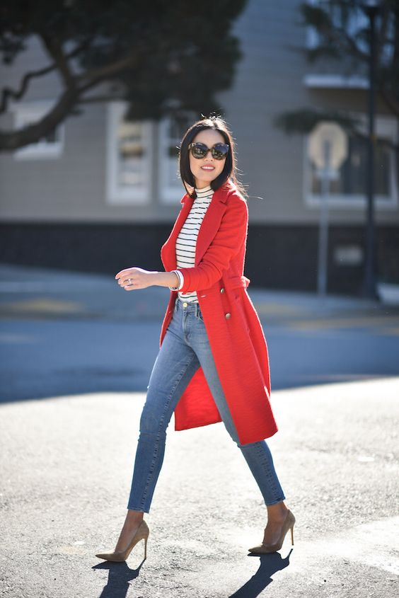 a striped turtleneck, blue skinnies, nude shoes and a coral coat for a statement