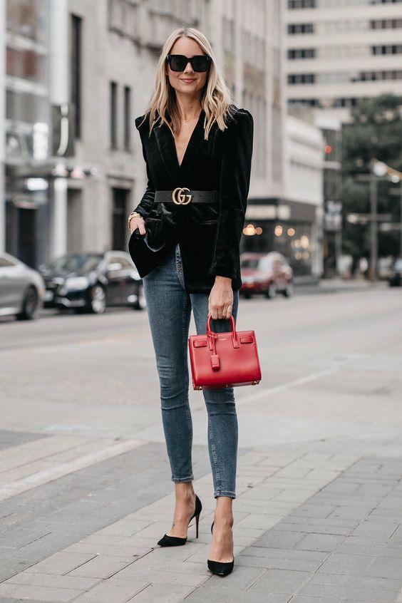 slate grey skinnies, black heels, a black velvet blazer with statement shoulders and a red bag
