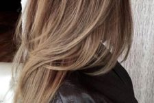 09 a chic long layered haircut with balayage and a darker root for highlighting the layers