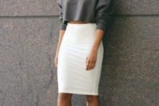 09 a gray cropped sweatshirt, a white pencil skirt, and sneakers for a minimal look