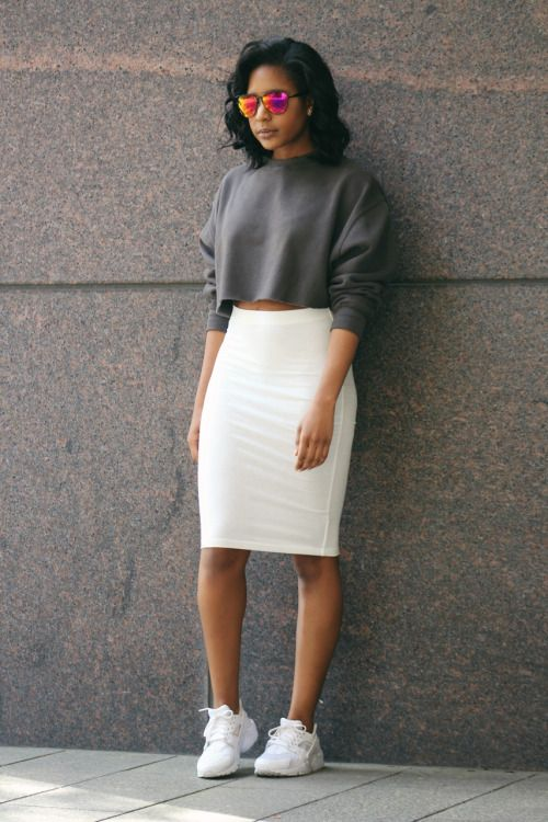 a gray cropped sweatshirt, a white pencil skirt, and sneakers for a minimal look