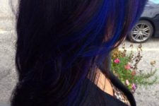 09 a long layered black haircut with bold blue and purple accents for a statement