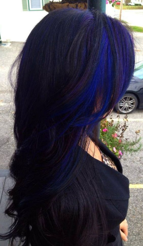 a long layered black haircut with bold blue and purple accents for a statement