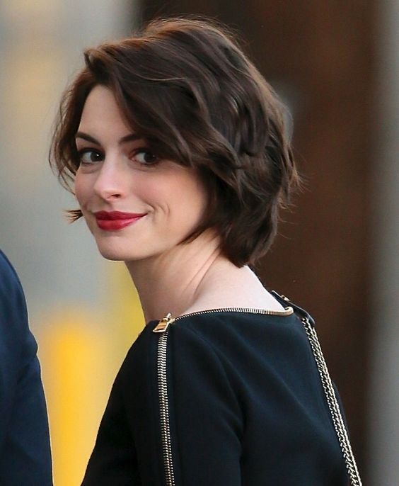 a short layered bob with light waves is an elegant option to rock anytime