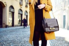 09 a total black look with a dress and heels and a mustard coat as a colorful touch
