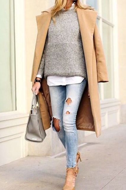 a white shirt, a grey sweater, blue ripped denim, nude shoes and a camel coat