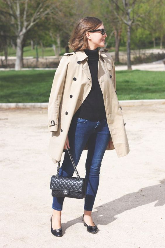 fall classics with navy skinnies, a black turtleneck, black flats and a tan short trench