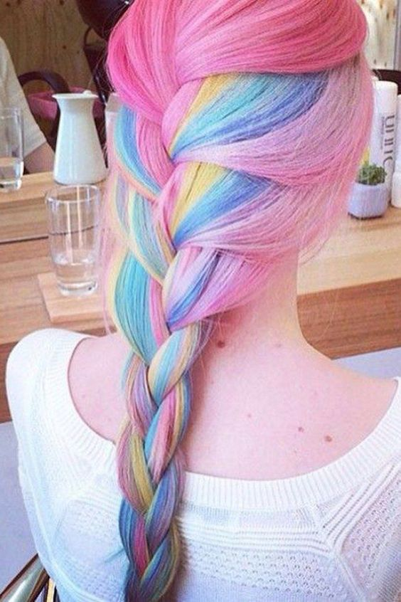 pink hair with a long rainbow braid is a bold and fun idea to rock