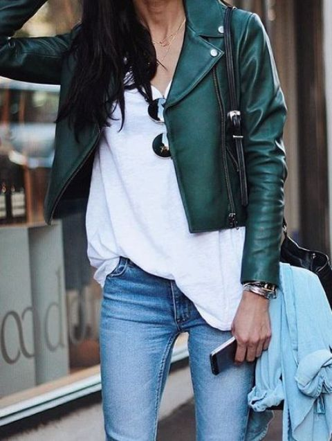 a green cropped leather jacket, a white tee, blue jeans for a casual look