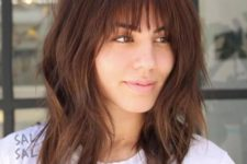 10 a layered long bob with a fringe and a bit of grunge for a bold look