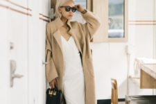 10 a white slip dress, black flat shoes and a bag and a long camel coat for fall neutrals