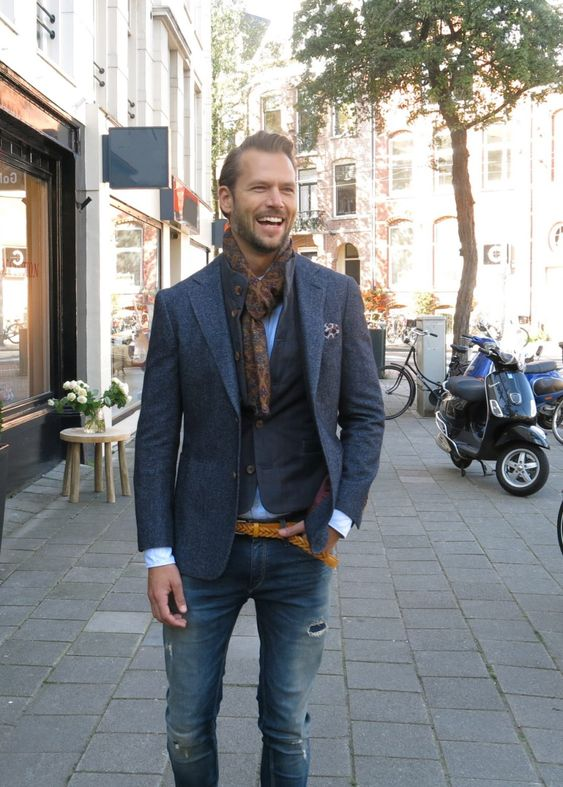 blue denim, a blue shirt, a blazer plus a waistcoat and a brown printed scarf for a touch of chic