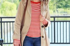 10 blue jeans, a striped long sleeve top, a tan short trench for early fall