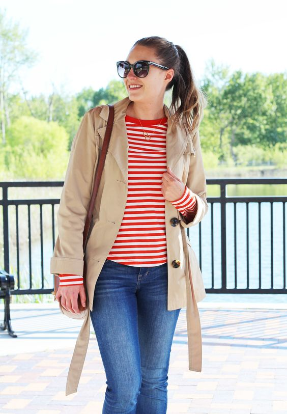 blue jeans, a striped long sleeve top, a tan short trench for early fall