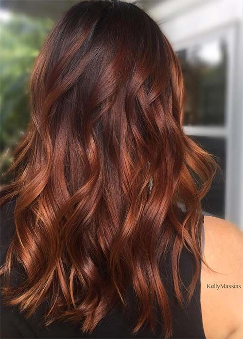 long auburn hair with a dark root and loose waves for a party
