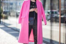 10 white sneakers, black leather pants, a printed tee and a hot pink midi coat