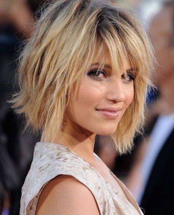 a cool short layered shaggy haircut with bangs and a dark root for a dimensional look