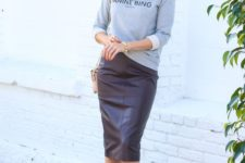 11 a grey printed sweatshirt, a burgundy pencil skirt, burgundy strappy shoes for a date