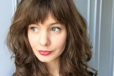 11 a medium length haircut with a straight bang is a chic and girlish idea