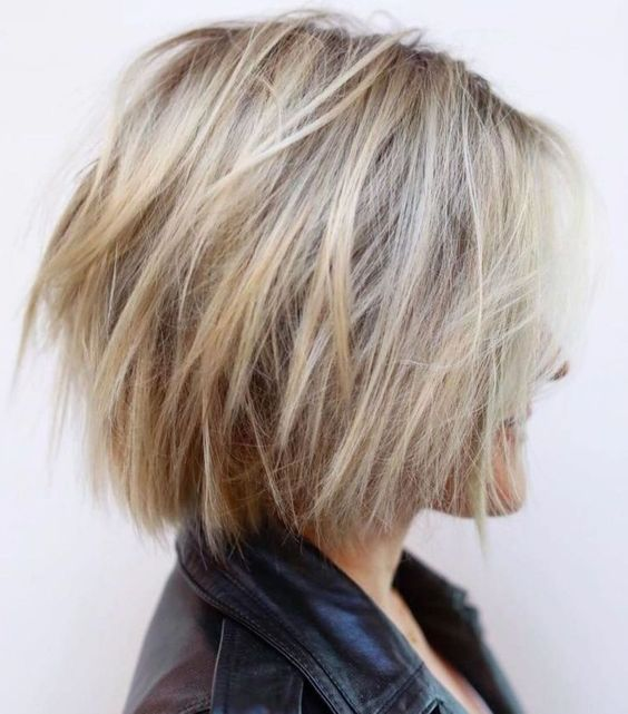 a shaggy blonde balayage short bob with a texture is a modern and cool idea