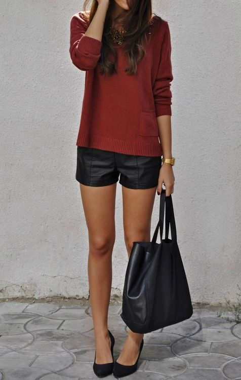 a simple look with black pumps, leather shorts and a bag and a burgundy sweater