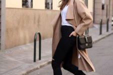 11 black ripped jeans, white sneakers, a white top and a long camel coat plus a black bag