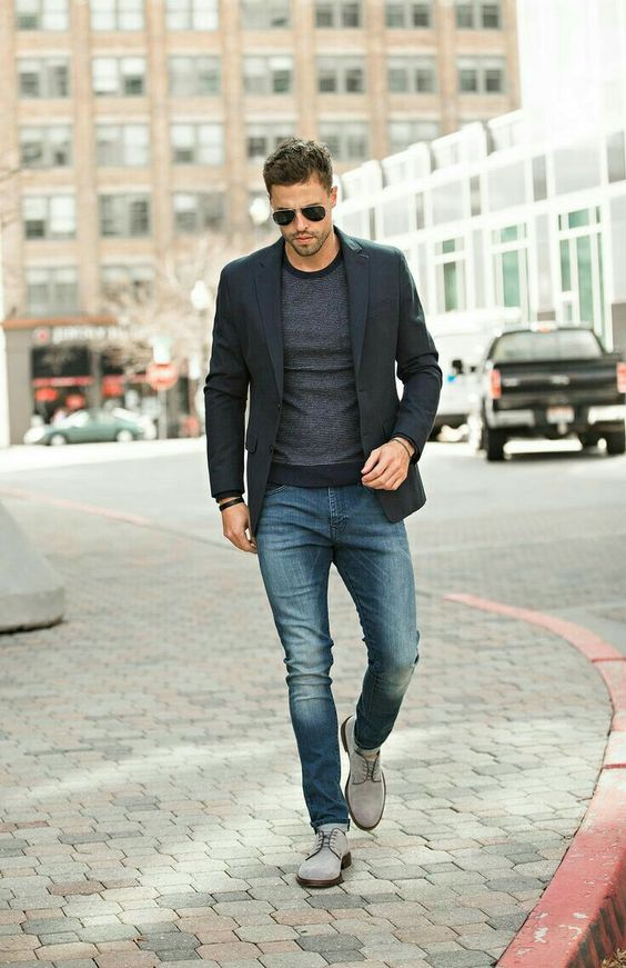 blue denim, a grey long sleeve top, a black blazer and grey suede shoes