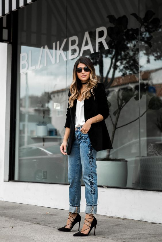 blue denim, a white top, black strappy heels and a black velvet blazer