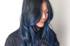 11 bold black to blue ombre hair on a long layered haircut for a statement