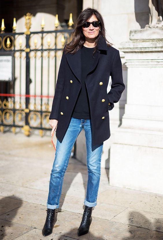 cuffed jeans, boots, a black top and a navy coat with gold buttons for a comfy feel