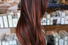 11 long auburn hair with a dark root for a contrasting and deep look