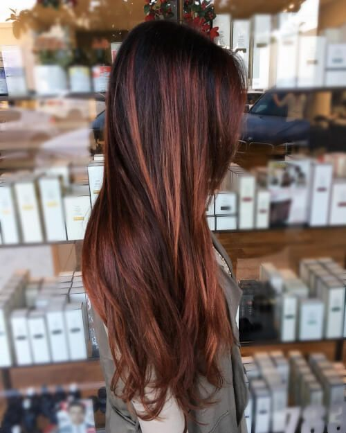 long auburn hair with a dark root for a contrasting and deep look