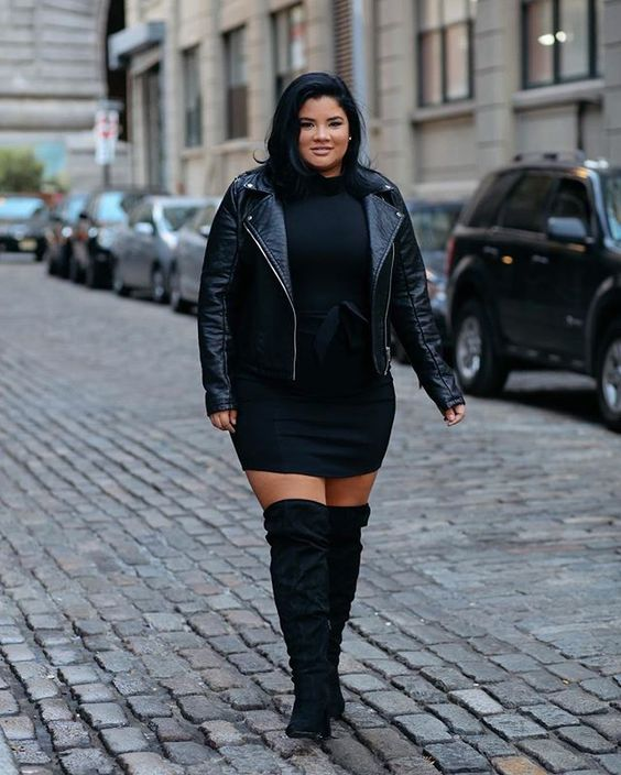 a black sweater dress, black suede boots, a black leather jacket for winter