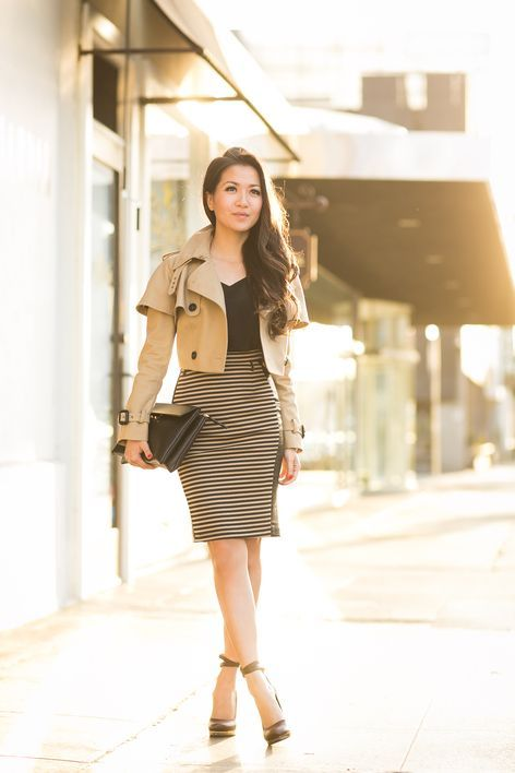a fitting dress with a striped skirt, a black top, black shoes and a cropped trench for a party