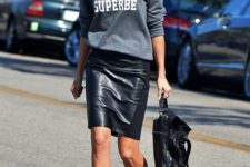 12 a grey sweatshirt, a black leather knee skirt and catchy shoes to make a stylish statement