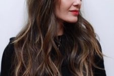 12 a long layered haircut with balayage and eyebrow-skimming bangs for an effortless look