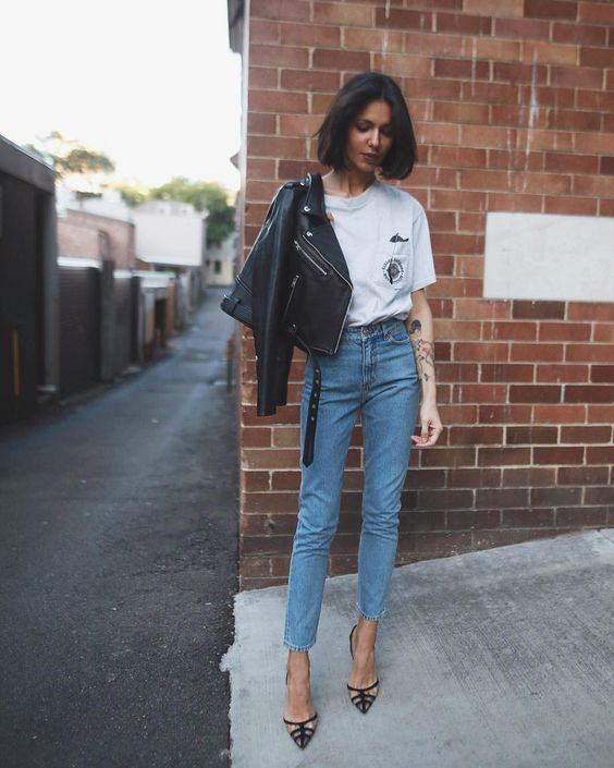 a printed tee, blue cropped jeans, printed shoes and a black cropped leather jacket