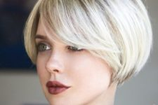 12 a short bob with side bangs is a chic retro-inspired idea