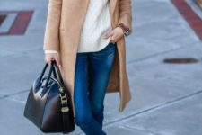 12 blue cropped skinnies, a creamy sweater, a camel coat, black slipons and a black bag