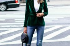 12 blue girlfriend jeans, a white turtleneck, an emerald velvet blazer, black shoes and a bag