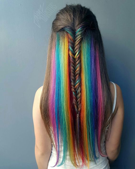 chestnut hair with bright rainbow dying that highlights the length