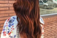 12 long auburn hair with red highlights and loose waves for a bright look