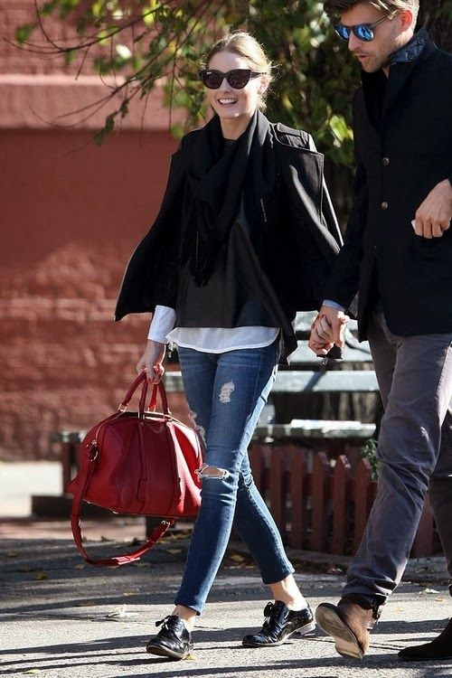 ripped skinnies, black shoes, a white shirt plus a black sweater, a black scarf and a short coat