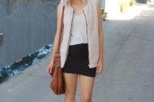 13 a black mini, a white tee, black booties, a blush faux fur vest and a brown bag