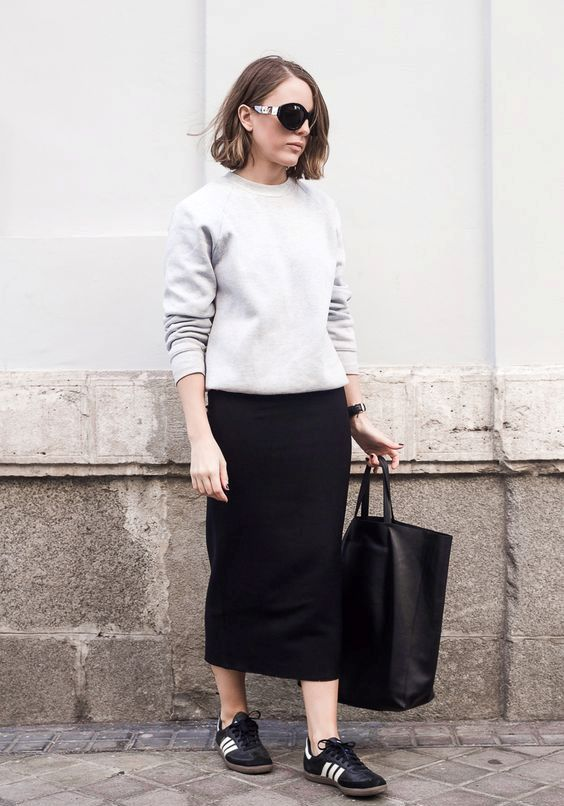 a grey sweatshirt, a black midi pencil skirt and black sneakers for an everyday look