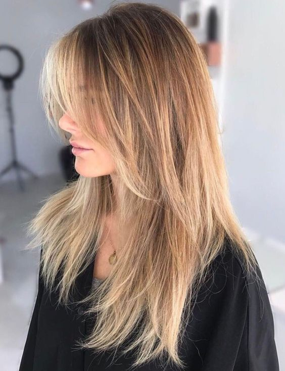 a long layered haircut with caramel balayage and shaggy touches for a wow look
